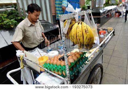 BANGKOK THAILAND-JUNE 25: An unidentified man sale Roti on the walking street on June 252012 in Bangkok Thailand