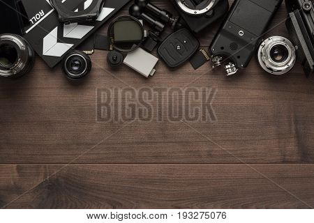 different video making equipment on brown table. video making equipment on wooden background. video making tools with copy space. indie video making essential equipment top view