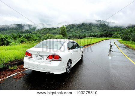 White Honda Civic Car In The Wet Road