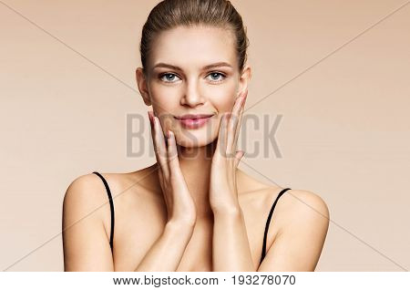 Beautiful girl with beautiful makeup. Photo of smiling girl on beige background. Youth and skin care concept