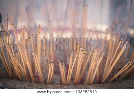 Burning joss sticks or Incense with smoke.