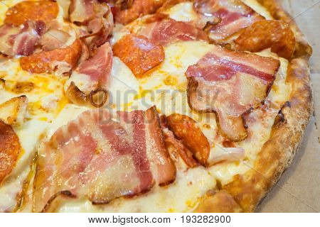 Serving Pizza with ham and cheese. Delicious Italian fast food. Cakes for fun - no diet! Cakes for fun - no diet!