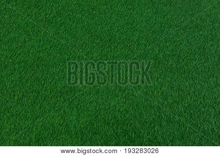 Dark green grass carpet cover for background football field.