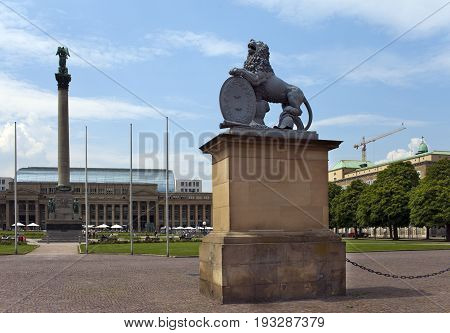 Lion sculpture with crest in front of the main entrance of the New Castle (Neues Schloss) in Germany Stuttgart