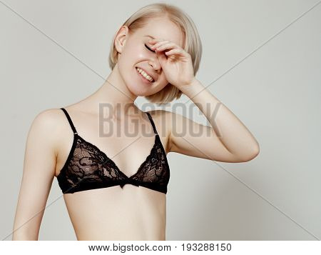 Vivacious Sexy Young Blonde Woman With A Beautiful Smile Posing In A Black Lingerie Isolated Studio
