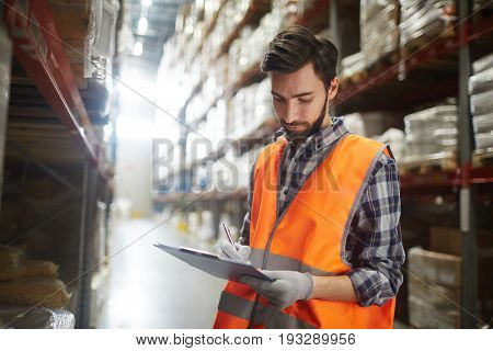 Distribution manager making revision of goods in storehouse
