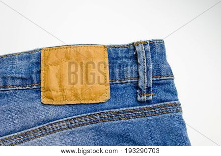 close up view of back pocket vintage blue denim jeans pant fashion texture background isolated on white background selective focus