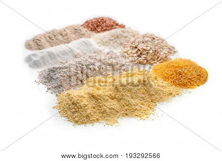 Different types of flour on white background