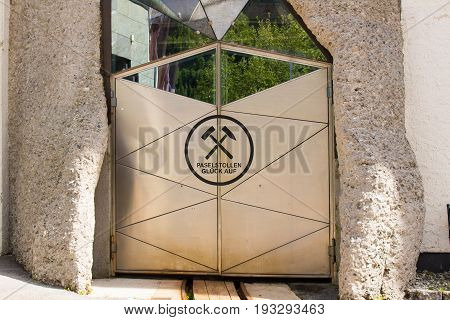 Bad Gastein Austria - JUNE 09 2017: Entrance for the railway into the mountain. At the health Resort Paselstollen a former Gold mining tunnel Bad Gastein Austria Europe.