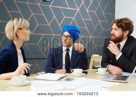 Team of young tv studio colleagues having meeting