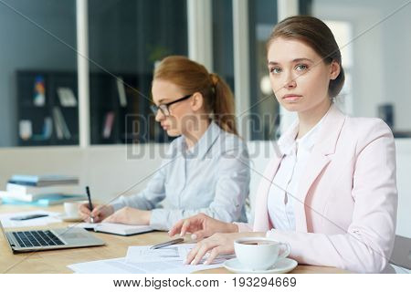 Busy female working with papers in office