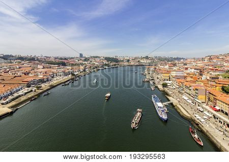 Porto landscape view over Douro River and turistic boats on a summer day Portugal.