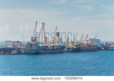 Toamasina Madagascar - December 22 2017: Ships in import export and business logistic port of Toamasina (Tamatave) Madagascar. Toamasina is the nation's chief port and is connected by rail with Antananarivo.