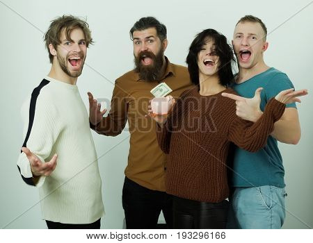 Excited group of friends or people pretty woman or cute girl and three men in casual wear shouting and putting money dollars in piggy bank on white background. Savings budget finance and moneybox