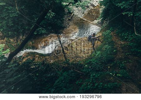 Male Climber Climbs The Hill On Waterfall Background Hiking Mountain Adventure Concept