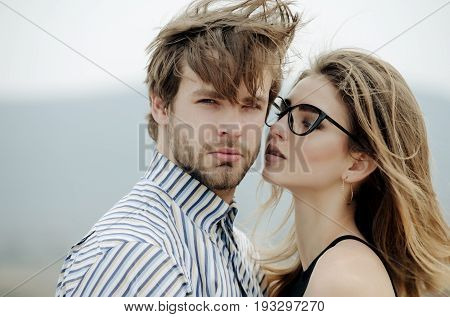 Sexy Girl In Stylish Glasses Looking At Handsome Man