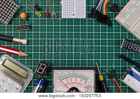 Diy Electrical Maker Tools Components On Green Cutting Mat Board. Diy Electrical Maker Tools With Co