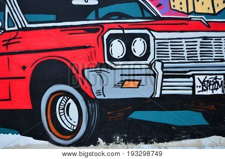 A Detailed Image Of The Graffiti Drawing. A Conceptual Street Art Background With A Red Lowrider Car