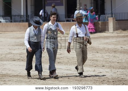 El Rocio Spain - June 2 2017: Group of male pilgrims in traditional dresses in a street of El Rocio during the pilgrimage Romeria 2017. Andalusia Spain