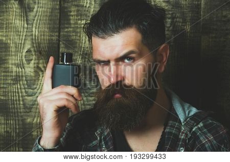 Hipster Posing With Black Perfume Or Cologne Bottle
