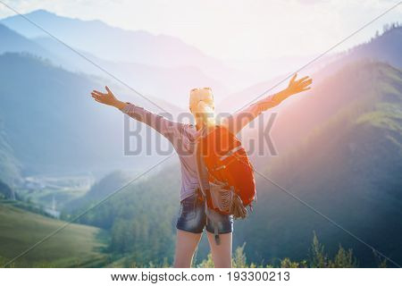 Woman hiking outdoors with Backpack. Eco Tourism
