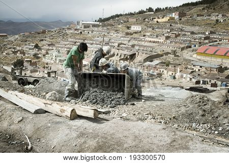Miners emptying mine cart at Cerro Rico silver mine in Potosi. October 8 2012 - Potosi Bolivia