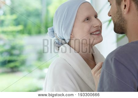 Young happy woman feeling better and looking at her husband