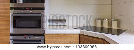Panoramic photo of functional modern kitchen design