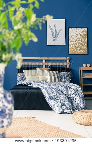 White and blue bedclothes in stylish bedroom