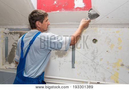 Hands Plasterer At Work