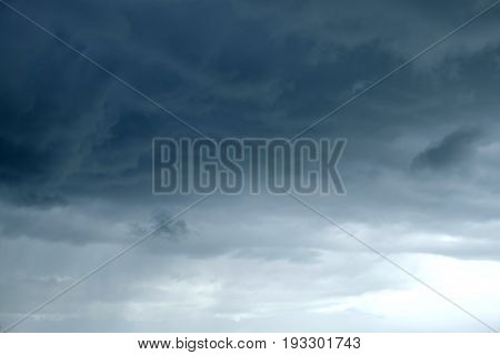Landscape with bad weather with storm sky with many heavy deep dark rainy clouds