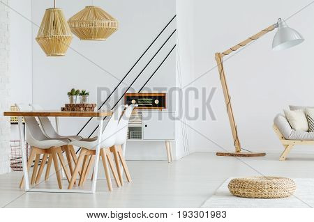 Two wooden lampshades hanging above the table in dining room