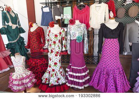 El Rocio Spain - June 2 2017: Traditional spanish flamenco dresses for sale in El Rocio during the Romeria 2017. Province of Huelva Almonte Andalusia Spain