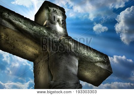 Crucifixion Jesus Christ. Jesus Christ public statue on the sky background