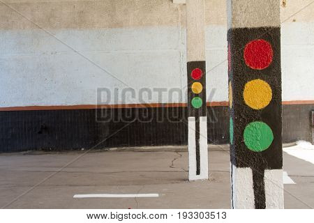Traffic light in the city painted on the wall.