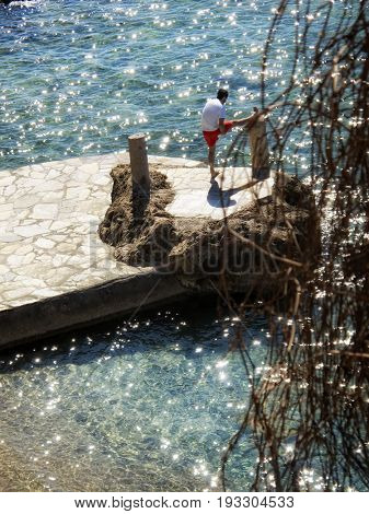 elevated view of young man relaxing on seaside