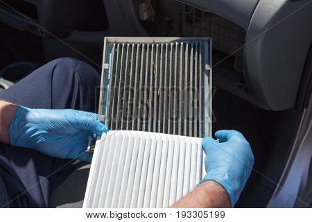 Replacing the cabin air filter. Old and new cabin air filter for car.