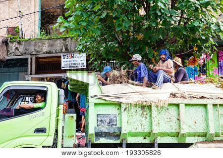 Workers Rides In The Back Of The Truck