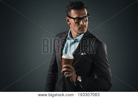 Portrait Of Stylish Man With Coffee To Go In Hand Looking Away Isolated On Grey