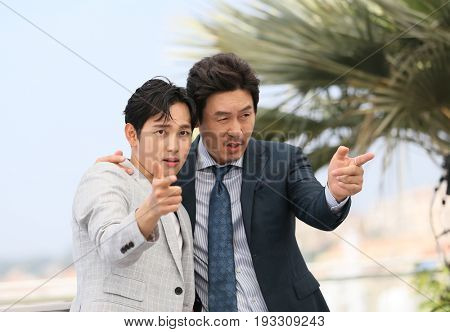 Yim Si-wan (L) and Kyoung-gu Sul attend the 'The Merciless' photocall during the 70th annual Cannes Film Festival at Palais des Festivals on May 25, 2017 in Cannes, France.