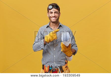 Happy Maintenance Worker Or Repairman With Dirty Face Wearing Protective Eyewear, Gloves And Belt Wi