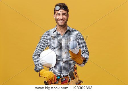 Portrait Of Happy Male Worker In Casual Clothes, Wearing Protective Eyewear, Gloves And Having Tool