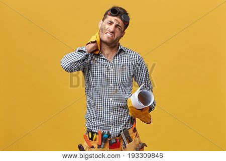Tired Repairman Having Exhausted Look After Long And Stressful Day Of Work Holding His Hand On Neck
