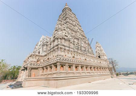 Bodh Gaya style stupa at Wat Chong Kham Phra Aramluang Ngao District Lampang Thailand.
