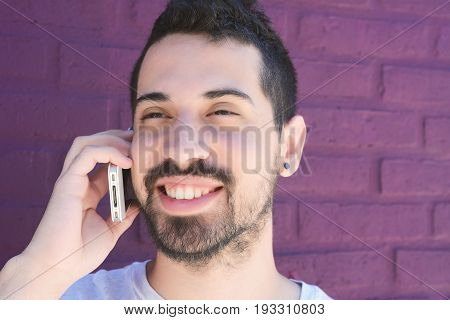 Portrait Of Latin Man Talking On The Phone