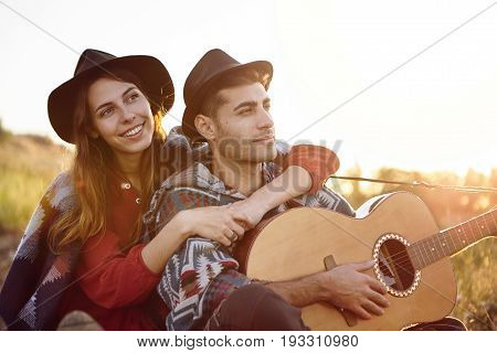 Couple In Love Having Date Outdoors On Beautiful Meadow Dreaming About Something Pleasant Playing Gu