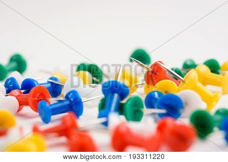 thumbtacks red green yellow on white background isoloated