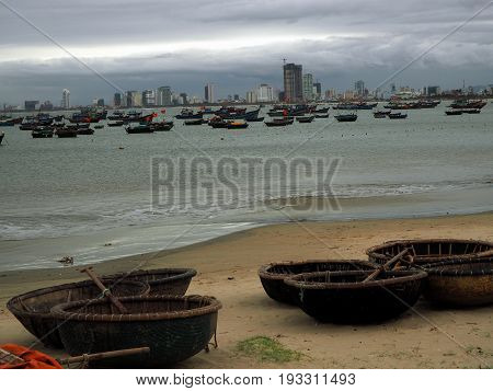 The seashore with fishing boats near Danang in Vietnam