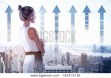 Side view of attractive young woman on city background with upward arrows. Success concept. Double exposure