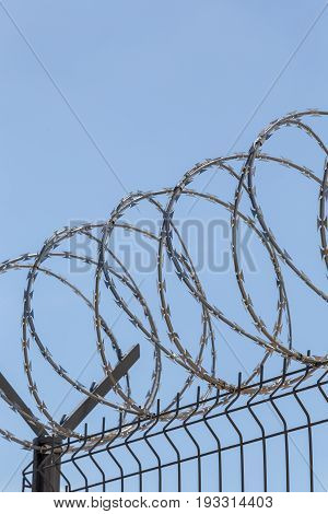 barbed wire on the blue sky background
